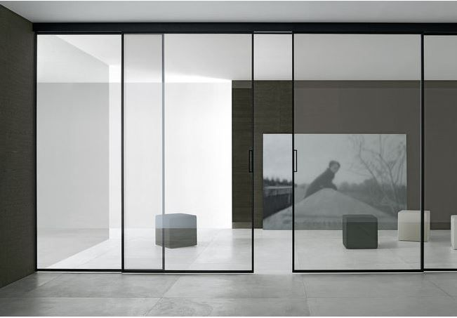 Velaria Sliding Doors by Rimadesio are highly customizable. Choose from a variety of Rimadesio glasses and aluminum, titanium, or oak framing. #doors #slidingdoors #interiors #design #hauteliving #chicago