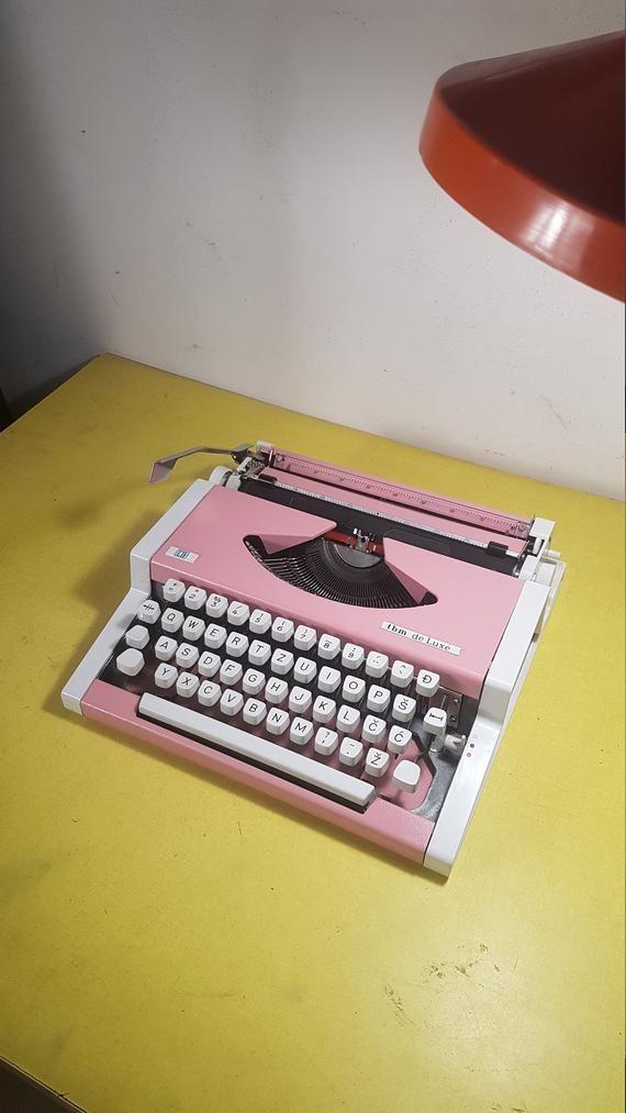 Vintage UNIS typewriter with case