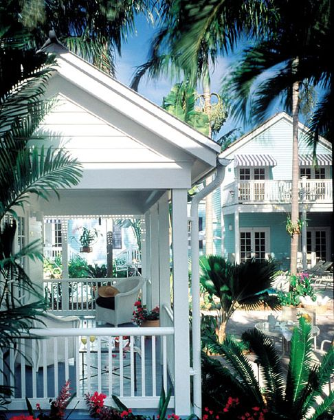 Restored 1884 conch houses set back from busy Duval Street in Key West.