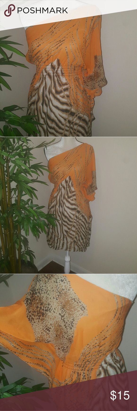 One Shoulder Dress vibrant orange with leopard pri Bisous Bisous one arm shoulder shear type of material with a stretchy gathered material in the waist for a beautiful fits vibrant Orange/ brown leopard print. Bisous Dresses One Shoulder