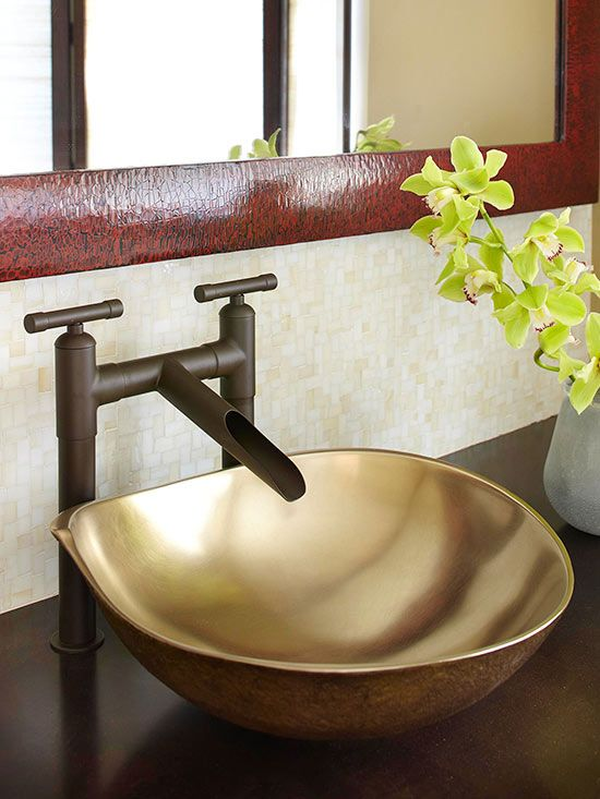 An Asian-inspired sink-and-faucet combo blends effortlessly with the bathroom's serene aesthetic. The interior of the bronze sink bowl was polished to a glowing sheen, while the exterior was left rough. The sleek faucet, in a custom finish, adds another layer of rustic appeal.