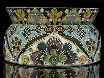 Silver and shaded cloisonne enamel open salt by Feodor Ruckert, Moscow, 1908-1917, enameled with highly stylized floral and geometrical designs. Diameter 2 in. (5,2 cm).