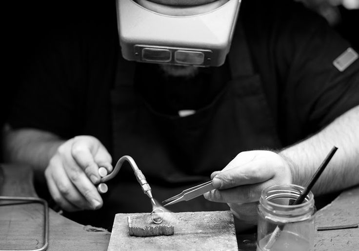 One of our Goldsmiths soldering in an additional piece of gold to increase the size of the ring. #soldering #resize #workshop #timothyroe
