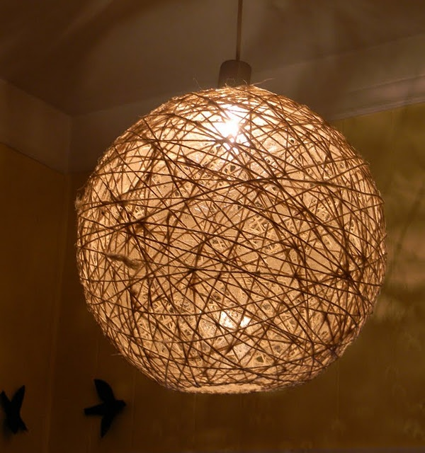 Make a twine light fixture with mod podge and a balloon.