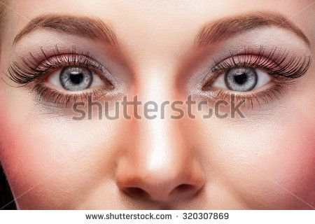 Expressive eyes with make up and big eyelashes. Studio shooting. Beauty face. Advertising for make up
