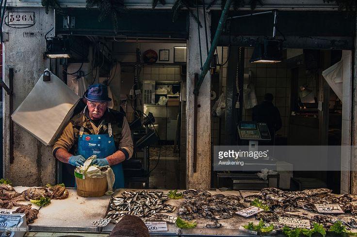 A fishmonger at Rialto fish Market in Venice #italianfood #venice ph @SimonPadovani for @awakeninginfo @GettyImages