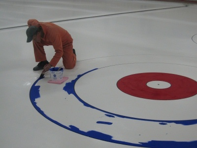 """old fashion paint is the secret.... the """"target"""" on the ice is called the house and the circles are called the rings... Blue ring is called the 12ft, the white the 8ft and the red the 4ft... center is called the button or the pot.. red, white and blue are traditional colors but you might see others..."""