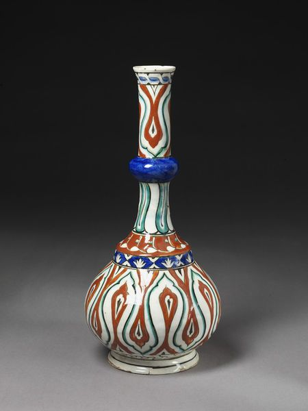 Bottle | Iznik, Turkey, ca. 1545 | Fritware, underglaze polychrome painted, glazed | Long-necked bottle with decoration in thickly applied red bole; reciprocating design on body and upper neck looks like teardrop shapes with pointed lobes | VA Museum, London