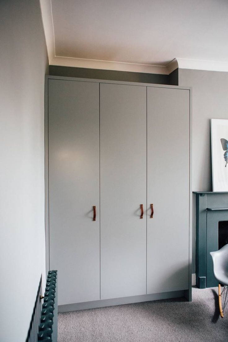 Spray painted wardrobes with push to open doors and oak veneered birch ply plywood interiors, with 3 internal drawers with routed scoop handle