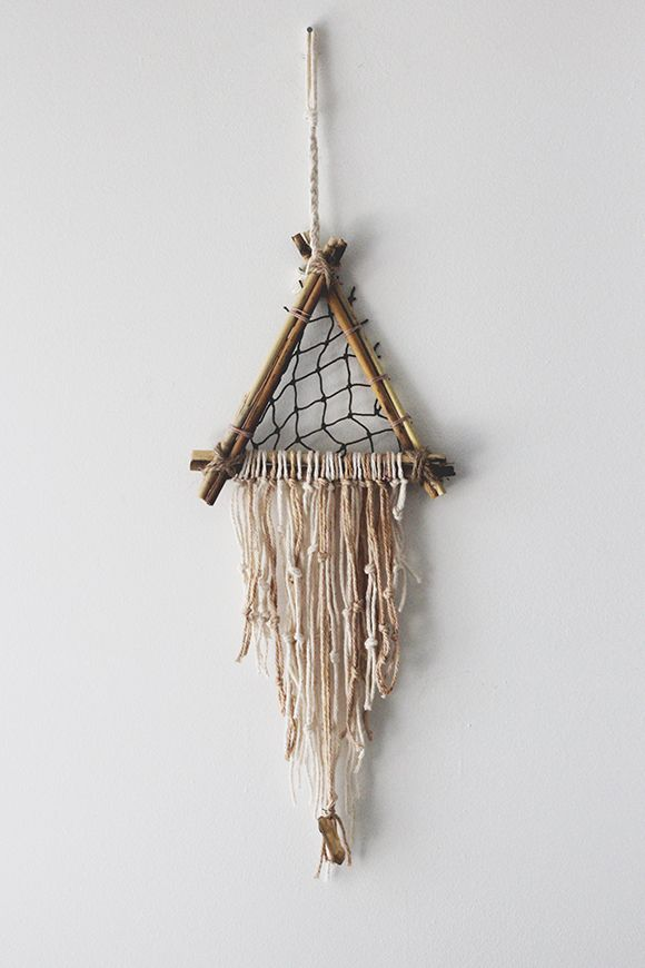 In my opinion, the perfect dreamcatcher always includes a crystal in some way, whether it's woven into the netting or hanging down at the bottom. I love how this lemon quartz goes with the beachy color scheme of this dreamcatcher.