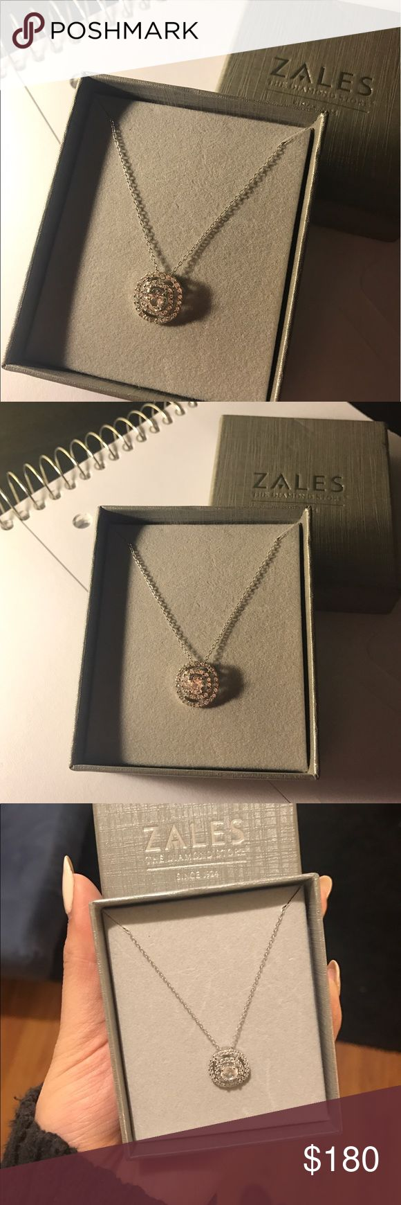 Diamond Necklace from Zales the Diamond Store This beautiful, new, and never worn necklace is from Zales. It's really sparkly but it has a simple touch. I still have the box it came with. Zales Jewelry Necklaces