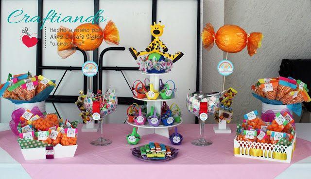 Mesa de dulces y botanas colorida arcoiris para for Mesa dulce para baby shower