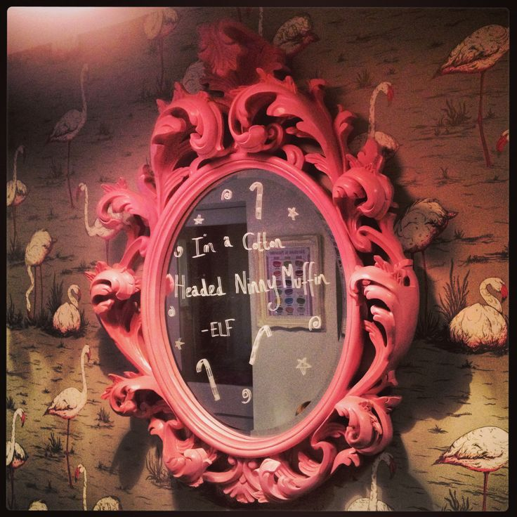 Write quotes from famous Christmas films on a mirror in chalk pen