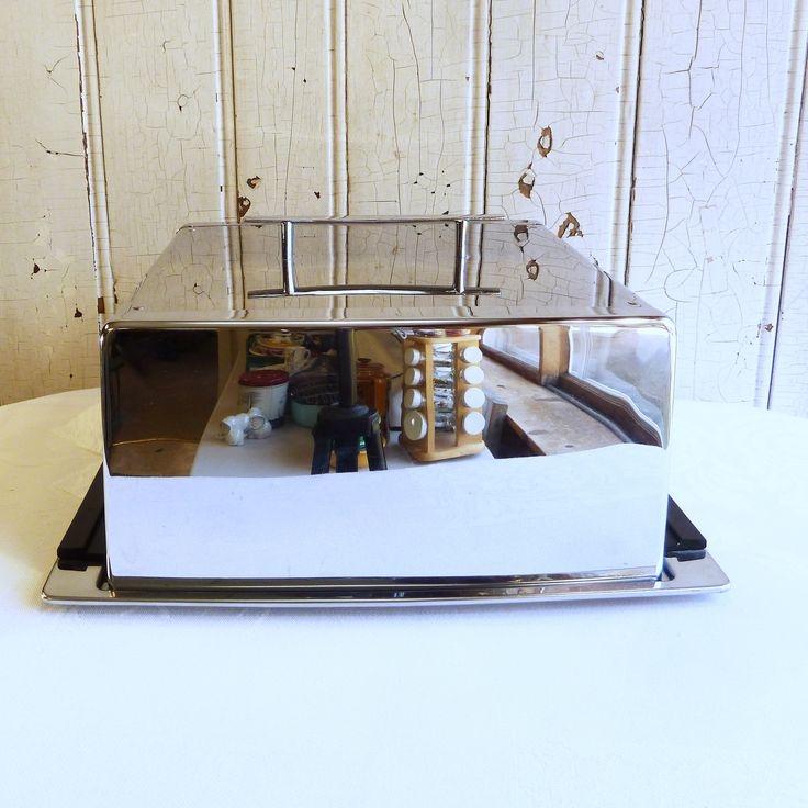 Great midcentury modern chrome cake carrier with black