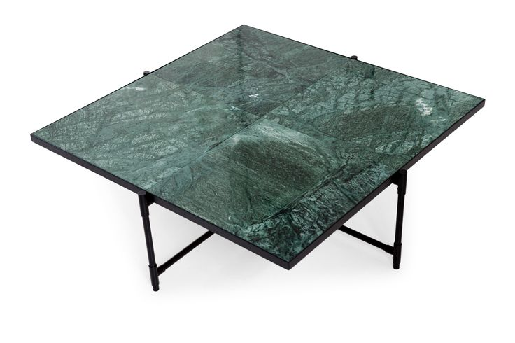 Coffee Table 90 // Green Marble  Our goal with this coffee table was to create a brand new expression, whilst still sustaining the simple and applicable nordic DNA that imbue HANDVÄRK.  The result is a generously proportioned, low coffee table. The expression is streamlined and contemporary, largely characterized by the fragments of nature: marble that has been quarried into 4 pieces - making this table a modern version of the tile top table