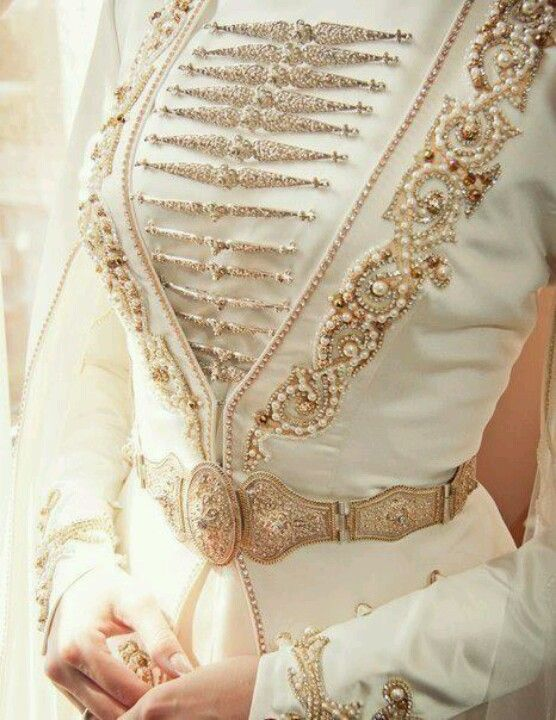 Steampunk wedding gown or jacket. (IMO, it'd go just super with my white patent leather majorette hat.)