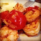 king prawns with tomatoes cherry and caramelized onion