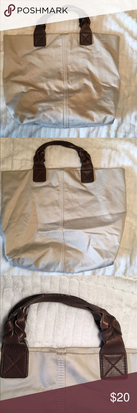 Gap tote in taupe/cream color Casual tote in a cream/taupe color. The inside has two pockets on one side and a zip up pocket on the other side. Some marks shown in pictures. GAP Bags Totes