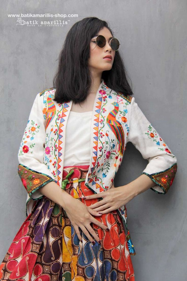 Batik Amarillis made in Indonesia www.batikamarillis-shop.com Batik Amarillis's Arcana Jacket - It's very unique & stunning military cropped inspired jacket,this contemporary and yet vintage style is featured with exquisite Mexican embroidery on Raw Tenun Gedog Tuban plus beautiful embroidery adornments on shoulder and sleeve it also features our triangle arcana tassels to complete the whole extravangant work.