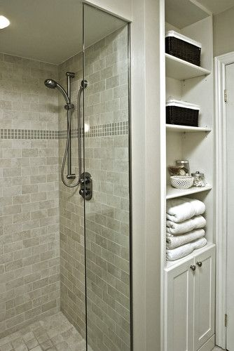 Creating a great storage layout is huge bonus for home buyers. If your home has a some extra space, knock out a small portion of the wall and a cabinet with shelving for towels and other bathroom items!