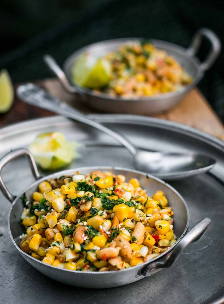 Indian spices liven up this fresh (or frozen) corn recipe, with crunchy peanuts, sesame, ginger and chiles. An excellent vegetarian main course or side dish