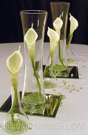 Mini calla lily - love the simplicity of one calla lily per vase