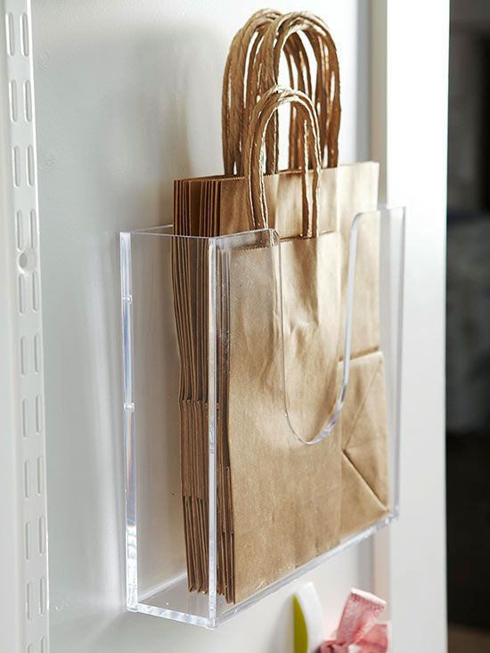 Use Open Storage – Office supply stores are a treasure trove of mostly inexpensive storage items that help to keep things collated, vertical, horizontal, or divided. These clear plastic display caddies hold a collection of reusable paper bags; attach the caddy to the back of the door with a very slim screw or adhesive tacks.