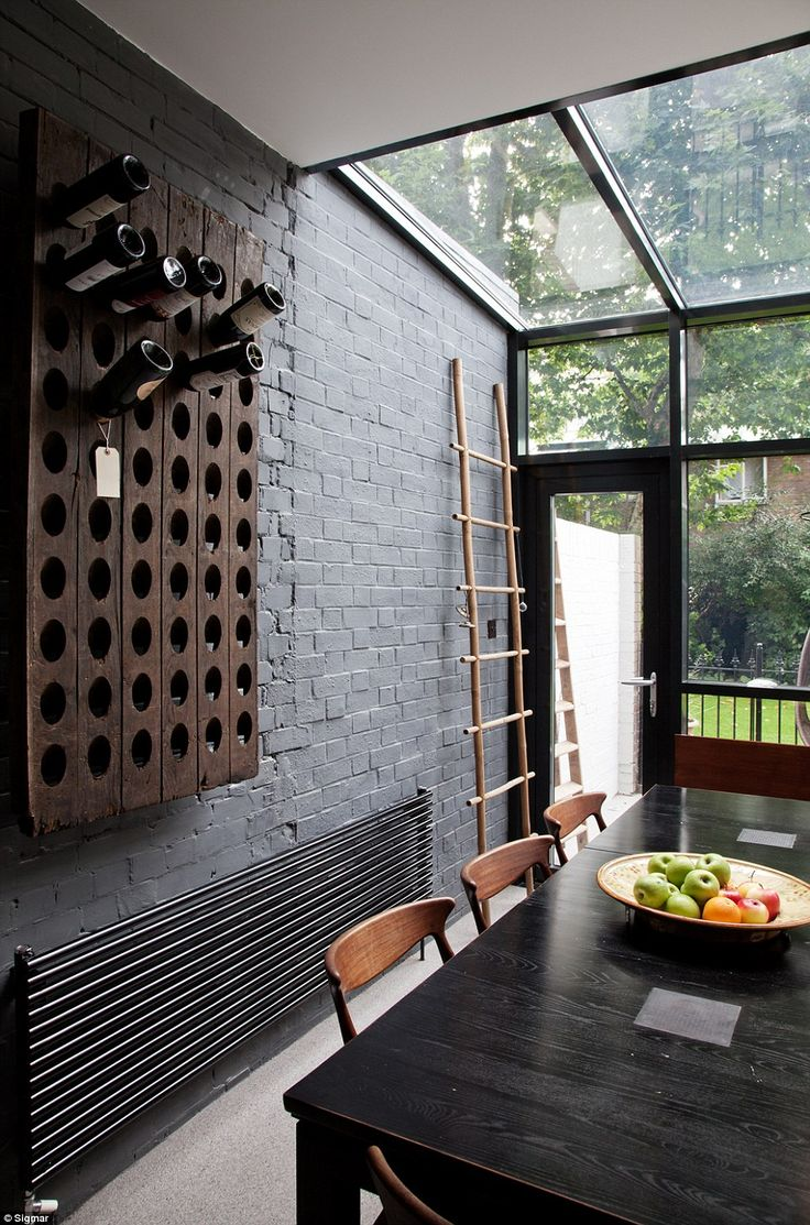 One of Houzz.co.uk most-favoured images is of a small kitchen in Clarendon Road, London, designed by interior designers Sigmar. Despite being a modest space the black brick wall against the glass doors and roof create a stylish yet achievable look