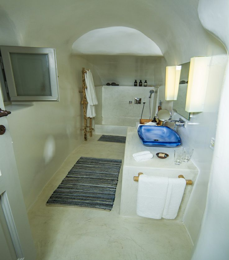 The Iconic Suite offers a generously sized bathroom and a separate rain shower area with basin...