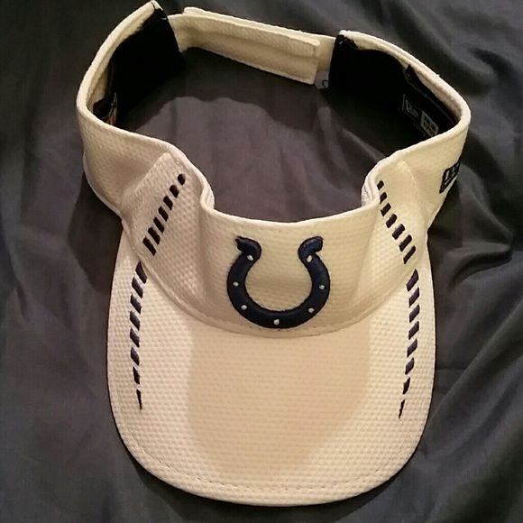 NFL Colts hat visor horseshoe football NFL Colts hat visor horseshoe football.  White and blue. In great condition. Like New.  Please lmk if you have any questions. Reasonable Offers accepted. Thank you for shopping my closet. :) NFL Accessories Hats