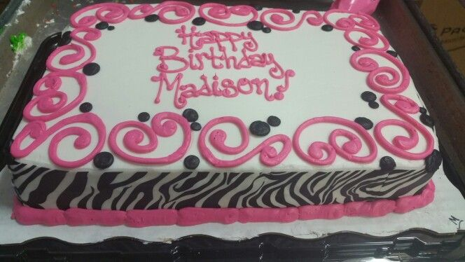Pink and black zebra print cake with scrolling.