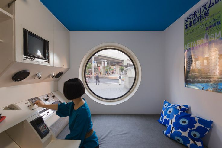 Japan, Shimashi, Nakagin Capsule Tower - The original target demographic were bachelor salarymen. The compact apartments included a wall of appliances and cabinets built into one side, including a kitchen stove, a refrigerator, a television set, and a reel-to-reel tape deck. A bathroom unit, about the size of an aircraft lavatory, is set into an opposite corner. A large circular window over a bed dominates the far end of the room.