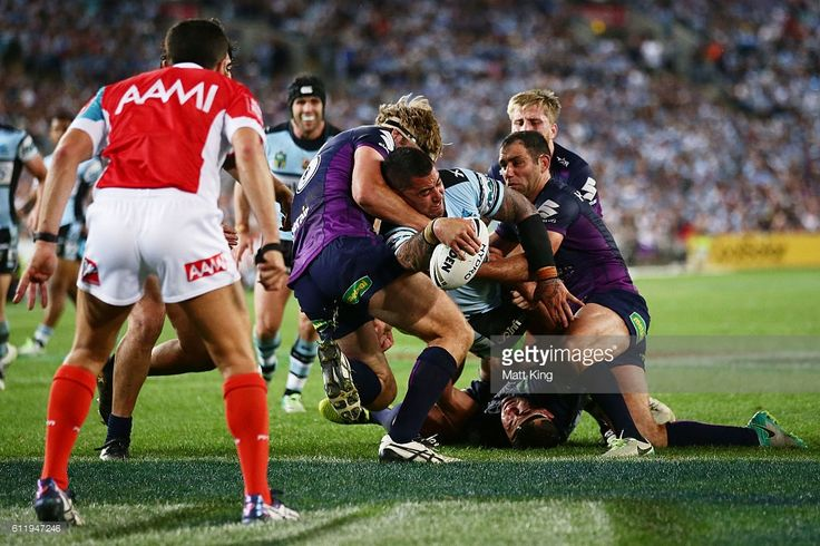 Andrew Fifita of the Sharks takes on the defence before scoring a try during the 2016 NRL Grand Final match between the Cronulla Sharks and the Melbourne Storm at ANZ Stadium on October 2, 2016 in Sydney, Australia.