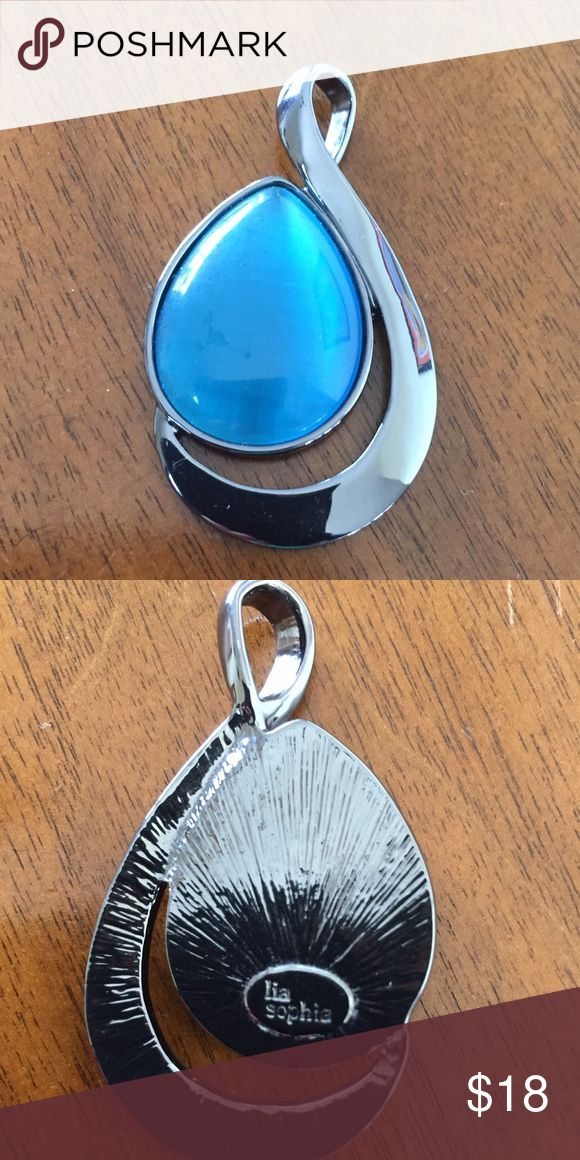Gorgeous Lia Sophia pendant. Beautiful.  Metal is a pewter color with a bright blue stone.  Very pretty design. Lia Sophia Jewelry