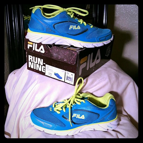 BNWT. . Fila running shoes BNWT. .. Fila running shoes. Brand new turquoise and yellow running shoes! Fila Shoes Athletic Shoes
