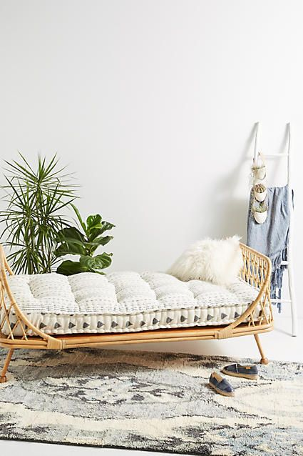 Anthropologie Pari Rattan Daybed - Formed from naturally durable rattan reeds, this curving daybed nods to British colonial furniture, providing a sturdy addition to your living space that doesn't take up too much visual weight. Use it on a sunporch to soak up warmth or with a cushion and a throw during colder months. [affiliate]