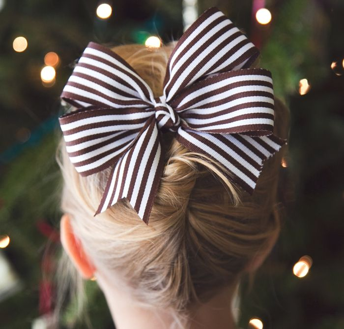 For several years I have resisted placing giant bows on the tops of my small daughters' heads but they have recently noticed that some girls wear magnificent gravity-defying ribbon-y creations piled high on their hair and they want in. I can't really blame them, even I have fallen victim to the big