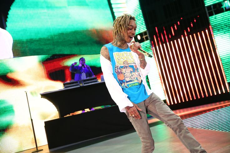 """Wiz Khalifa (@wizkhalifa) Performs New Song Live on WWE's Monday Night Raw [Video/ Photos]- http://getmybuzzup.com/wp-content/uploads/2015/03/RAW_03092015rf_1162-650x433.jpg- http://getmybuzzup.com/wiz-khalifa-performs-new-song/- Wiz Khalifa Performs New Song Live Pittsburgh's ownWiz Khalifaappeared live onWWE'sMondayNight Rawand performed his new song""""Go Hard or Go Home""""for the first time on TV. Sporting a John Cena shirt, Khalifa pumped up his ho"""