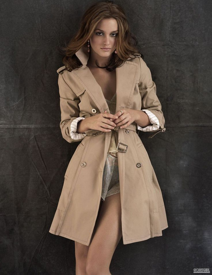 Brunette fashion model in grey coat backwards view stock image