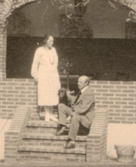 """The Buchholtz couple at their patio with their dog """"Stella"""""""