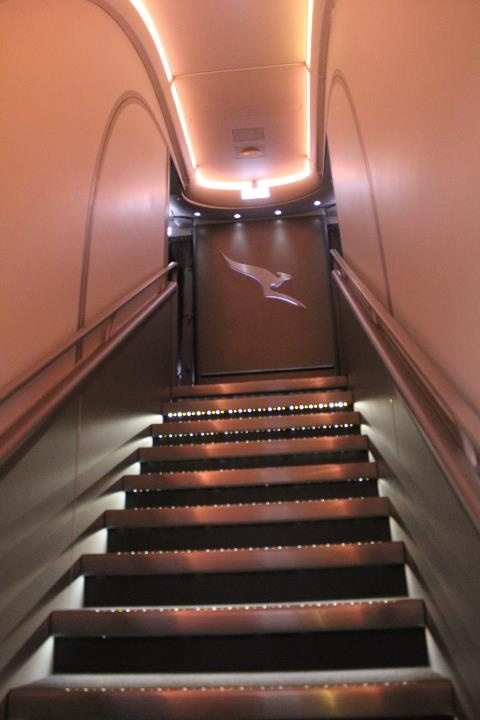 Stairs up to the business class cabin on one of QANTAS's ...