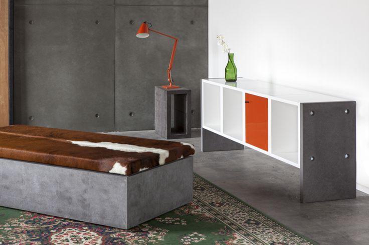 Concrete Cowhide ottoman by POPconcrete