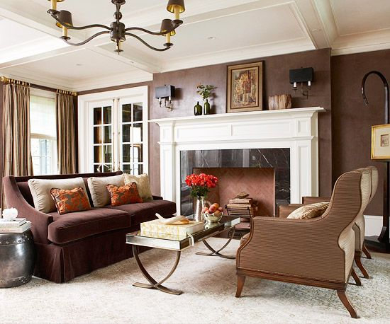 Dark walls and bright white molding add sophisticated contrast to this living room! More design ideas: http://www.bhg.com/rooms/living-room/makeovers/living-room-decorating-ideas/?socsrc=bhgpin092613sophisticatedlivingroom&page=16