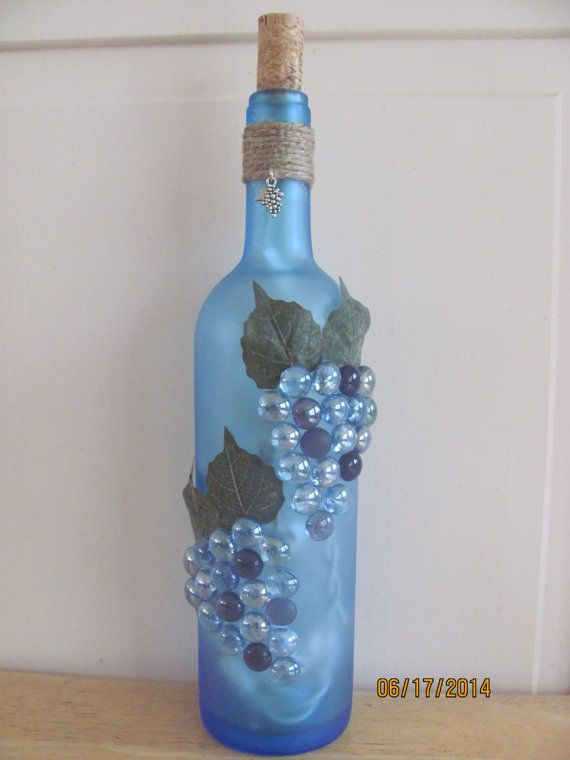Beautiful light blue frosted, lighted wine bottle