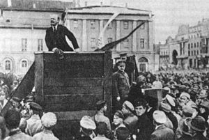 1917, Russian Revoution, March 8-November 8: Vladimir Lenin, leader of the Bolsheviks, speaks at a meeting in Sverdlov Square in Moscow, with Leon Trotsky and Lev Kamenev adjacent to the right of the podium.