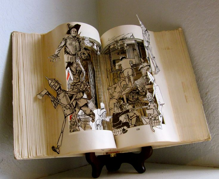 Altered Book - The land of Oz  the wizard of OZ book series. $300.00, via Etsy. This artist has some amazing pieces/books for sale