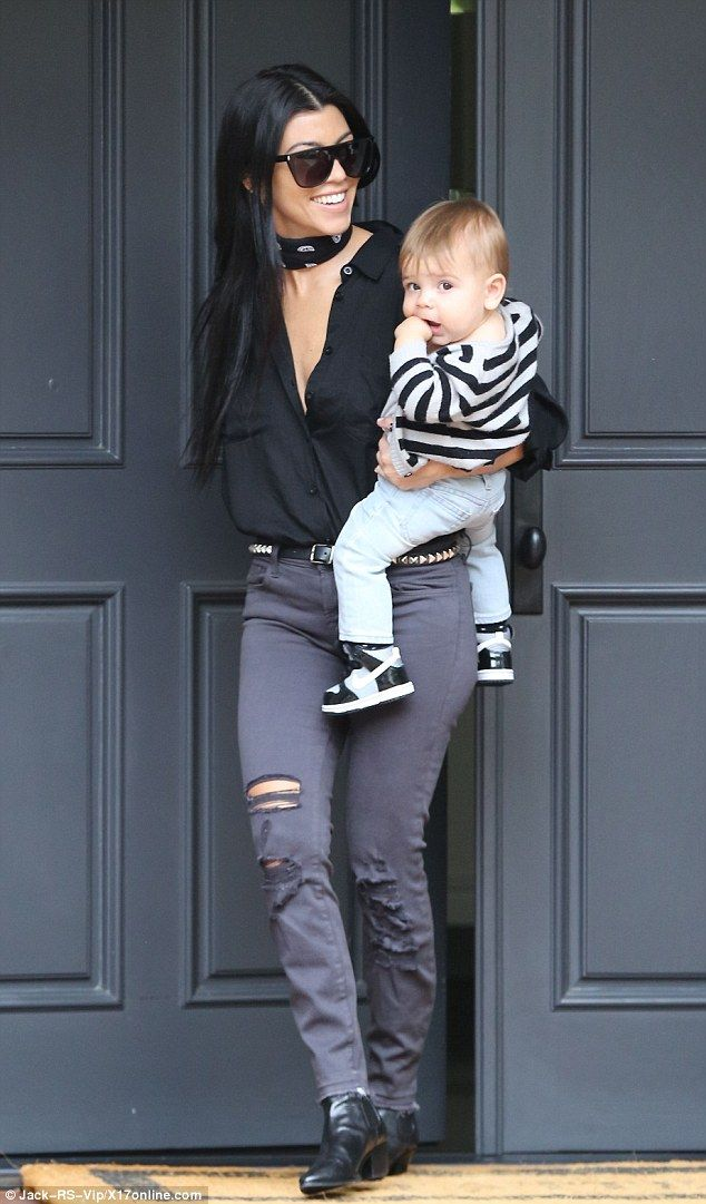 Mummy duty: Kourtney Kardashian was seen carrying her youngest son Reign on Thursday...