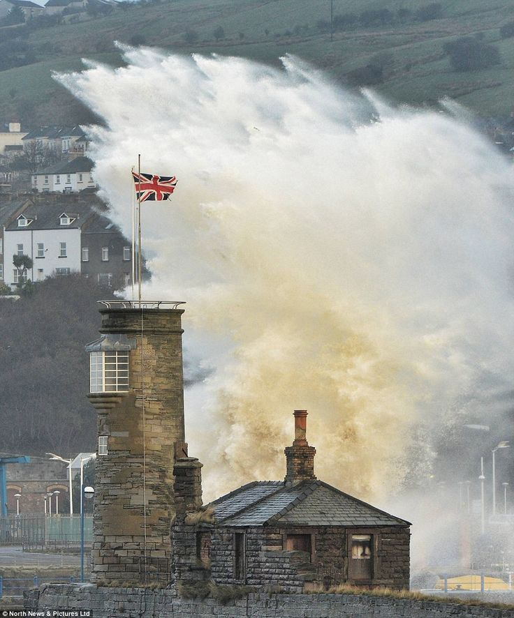 Splash: Huge waves engulf Whitehaven harbour. It is usually tranquil because the Cumbrian coastline is protected by Northern Ireland. This December the tidal surge and accompanying storm will be the worst in 30 years.