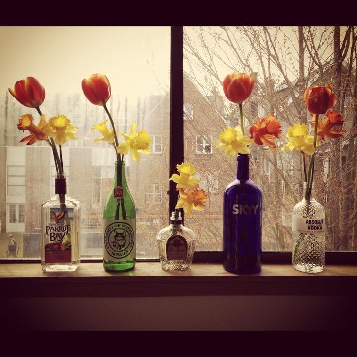 Bottles + flowers = College decor at its finest! :) @Carly Van @Cassie Van @Skylar Smits