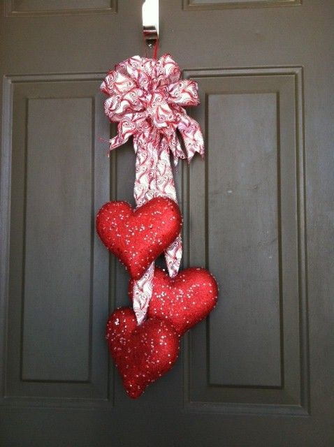 Cute Valentine Decor!  Hearts for door.  Made from purchased styrofoam glitter hearts (Hobby Lobby) hot glued on wired fabric ribbon.  Gather at top and make loop bow with remaining ribbon.  Wha-la!  Instant door decor!